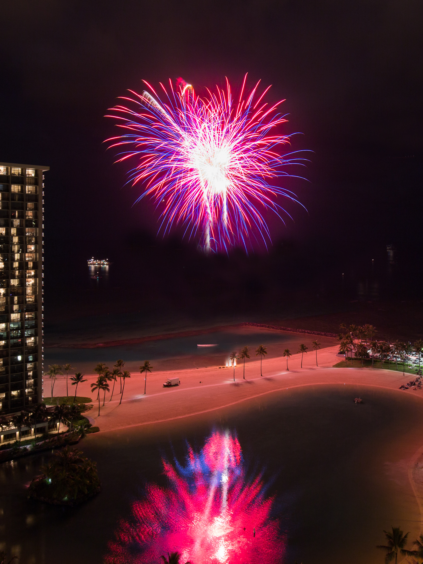 Fireworks light up the night outside the Ilikai on Waikiki beach